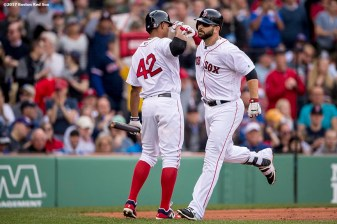 BOSTON, MA - APRIL 15: Mitch Moreland #18 of the Boston Red Sox high fives Xander Bogaerts #2 after hitting a solo home run during the second inning of a game against the Tampa Bay Rays on April 15, 2017 at Fenway Park in Boston, Massachusetts. (Photo by Billie Weiss/Boston Red Sox/Getty Images) *** Local Caption *** Mitch Moreland; Xander Bogaerts